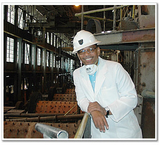 Gene Faison tours one of the copper mines in the Copperbelt. Copper mining is one of Zambia's largest industries.
